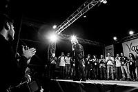 Palermo, Italy, 25 October 2012: Founder of the Five Stars Movement Beppe Grillo, 64, rallies in Piazza Magione supporting candidate for Governor of Sicily Giancarlo Cacielleri, a 37 years old surveyor from Caltanisetta,  in Palermo, Italy, on October 25 2012. Beppe Grillo, a comedian turned political guru, Grillo campaigned actively in Sicily, swam across the channel that separates the island from the rest of Italy, scaled its active volcano, Mount Etna, and drawed thousands of Sicilians to campaign rallies for his derisive stand-up routines.<br /> <br /> The direct elections in Sicily for the President of the Region and its representatives will take place on Sunday 28 October 2012, 6 months ahead of the end of the terms of office of the current legislature. The anticipated election of October 28 take place after Raffaele Lombardo, former governor of Sicily since 2008, resigned on July 31st. Raffaele Lombardo is under investigation since 2010 for Mafia ties. His son Toti Lombardo is currently running for a seat in the Sicilian Regional Assembly in the coalition of Gianfranco Micciché, a candidate for the Presidency of the Region. 32 candidates belonging to 8 of the 20 parties running for the Sicilian elections are either under investigation or condemned. ### Palermo, Italia, 25 ottobre 2012: il fondatore del Movimento 5 Stelle Beppe Grillo, 64 anni, fa un comizio in Piazza Magione per sostenere il candidato alla Presidenza della Regione Sicilia Giancarlo Cancelleri, un geometra di 37 anni di Caltanisetta, a Palermo il 25 ottobre 2012.<br /> <br /> Le elezioni in Sicilia per la votazione diretta del presidente della regionee dei deputati all'Assemblea regionale (ARS)si terranno domenica 28 ottobre, in anticipo sulla scadenza naturale dell'attuale legislatura, prevista ad aprile dell'anno prossimo. In Sicilia si vota in anticipo dopo le dimissionidel 31 luglio scorso di Raffaele Lombardo, eletto presidente della regione nell'aprile del 2008 e indagato dal 2010 per co