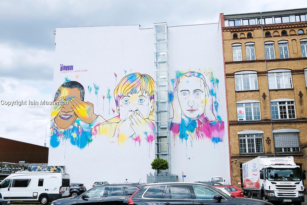 Modern street art mural featuring Barack Obama, Angela Merkel and Vladimir Putin painted on building in Kreuzberg Berlin Germany