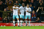 Michail Antonio of West Ham United (c) celebrates with his teammates after scoring his teams 2nd goal. Premier League match, Liverpool v West Ham Utd at the Anfield stadium in Liverpool, Merseyside on Sunday 11th December 2016.<br /> pic by Chris Stading, Andrew Orchard sports photography.