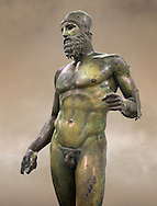 Torso of the Riace bronze Greek statue B cast about 460 - 450 BC. statue B was probably sculpted by Phidias. There is a sense of movement in the statues their legs being bent as if they are about to take a step. Their heads are turned which accentuates a sense of anticipation as if they are looking for something. The anatomical detail is extraordinary which gives a startling realism to the statue and demonstarte the high level of skill of the Greek sculptors of this period. Museo Nazionale della Magna Grecia,  Reggio Calabria, Italy. .<br /> <br /> If you prefer to buy from our ALAMY STOCK LIBRARY page at https://www.alamy.com/portfolio/paul-williams-funkystock/greco-roman-sculptures.html . Type -    Riace     - into LOWER SEARCH WITHIN GALLERY box - Refine search by adding a background colour,  etc.<br /> <br /> Visit our ROMAN WORLD PHOTO COLLECTIONS for more photos to download or buy as wall art prints https://funkystock.photoshelter.com/gallery-collection/The-Romans-Art-Artefacts-Antiquities-Historic-Sites-Pictures-Images/C0000r2uLJJo9_s0