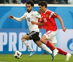 June 19, 2018 - Saint Petersburg, Russia - Mohamed Salah (L) of the Egypt national football team and Yury Zhirkov of the Russia national football team vie for the ball during the 2018 FIFA World Cup match, first stage - Group A between Russia and Egypt at Saint Petersburg Stadium on June 19, 2018 in St. Petersburg, Russia. (Credit Image: © Igor Russak/NurPhoto via ZUMA Press)