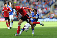 Cardiff city 's Matthew Connolly (l) battles for the ball with Everton's Steven Pienaar.. Barclays Premier league, Cardiff city v Everton at the Cardiff city Stadium in Cardiff,  South Wales on Saturday 31st August 2013. pic by Andrew Orchard,  Andrew Orchard sports photography,