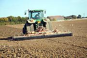 Tractor harrowing field, Parham, Suffolk, England