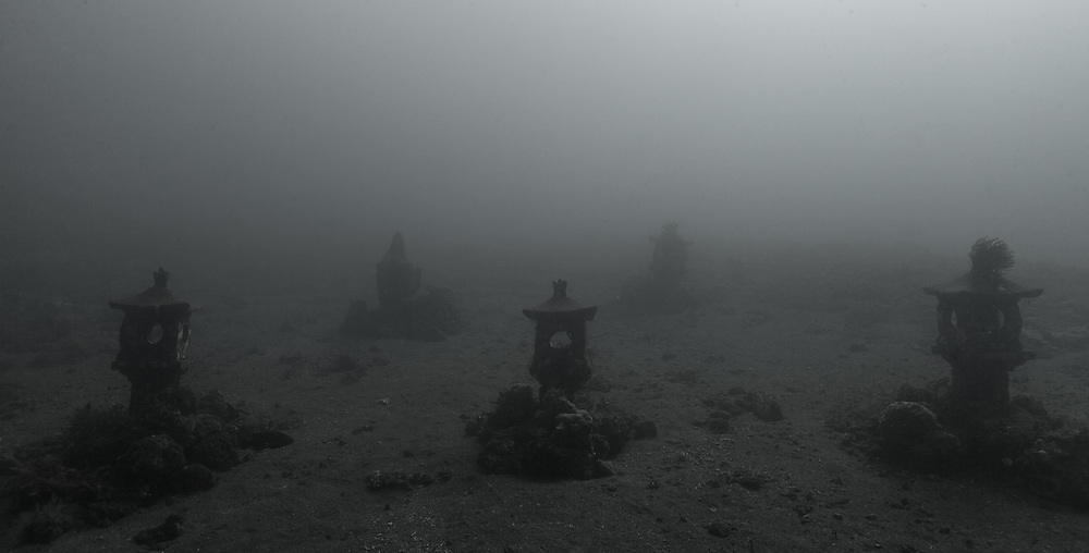 INDONESIA. Tulamben, Bali. June 19th. 2013. Small stupas sunken along a volcanic slope.  They are part of a Balinese style shrine that was sunk to become an artificial reef.