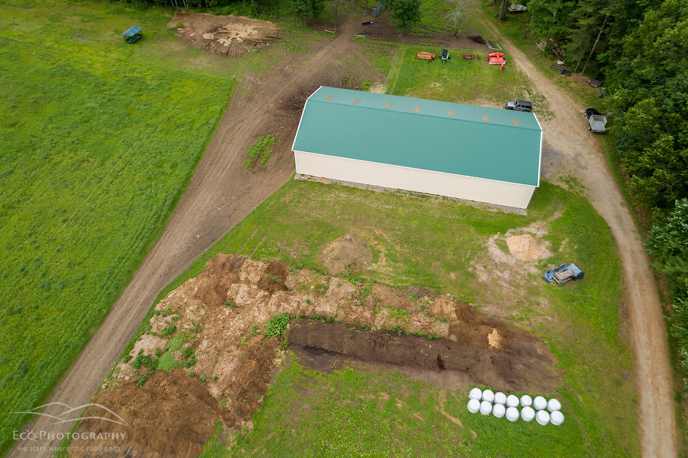 Barn, compost, and hay bales at Clarke Farm, Epping, New Hampshire.