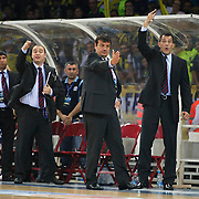 Efes Pilsen's coach Ergin ATAMAN (C) and co trainer Ufuk SARICA (R) during their Turkish Basketball league Play Off Final third leg match Fenerbahce Ulker between Efes Pilsen at the Abdi Ipekci Arena in Istanbul Turkey on Tuesday 25 May 2010. Photo by Aykut AKICI/TURKPIX
