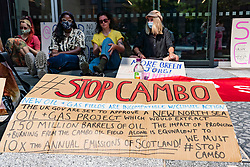 Edinburgh, Scotland, UK. 19 July  2021. Protestors opposed to the approval of new Cambo North Sea oil and gas field occupy HM Government Queen Elizabeth house in central Edinburgh today. Protestors are still inside and outside the building in the afternoon under police watch. Protestors cite global warming and climate change as a reason to leave all new oil and gas deposits in the ground undeveloped.  Iain Masterton/Alamy Live news.
