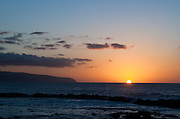 The sun sets off the Ka'ena Point in Hawaii.