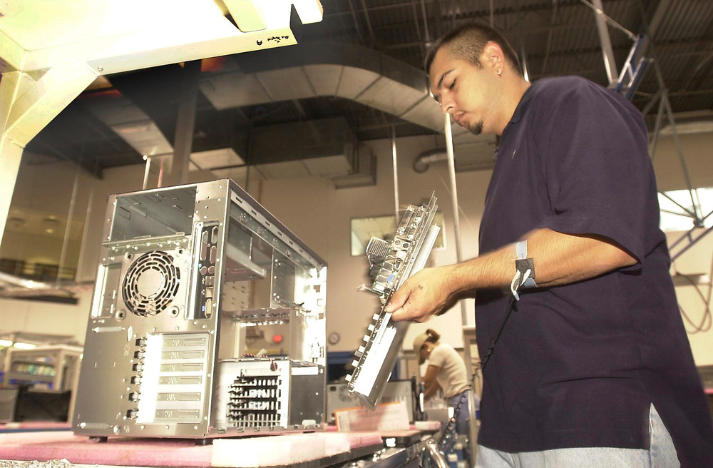 Austin, Texas 13JUL00:  Server Manufacturing process at Dell Computer facility in north Austin, Texas shows 'picking area' where electronic parts including computer motherboard  are installed on a server platform. Photos by Bob ©Bob Daemmrich