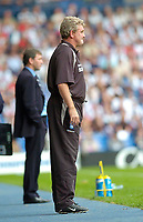 Photo: Leigh Quinnell.<br /> West Brom v Birmingham City. The Barclays Premiership. Birmingham manager Steve Bruce looks on with Bryan Robson in the background.<br /> 27/08/2005.