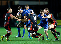 Caelan Doris of Leinster under pressure from  Ollie Griffiths of Dragons<br /> <br /> Photographer Simon King/Replay Images<br /> <br /> Guinness PRO14 Round 10 - Dragons v Leinster - Saturday 1st December 2018 - Rodney Parade - Newport<br /> <br /> World Copyright © Replay Images . All rights reserved. info@replayimages.co.uk - http://replayimages.co.uk