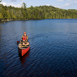 Canoeing on Prong Pond near Moosehead Lake in Maine.  Owned by Plum Creek.