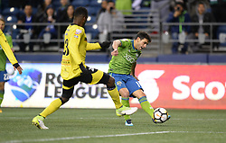 March 1, 2018 - Seattle, Washington, U.S - Soccer 2018: NICO LODEIRO (10) sends a ball for an assist to WILL BRUIN for a Sounders goal as Santa Tecla FC visits the Seattle Sounders for a CONCACAF match at Century Link Field in Seattle, WA. Seattle won the match 4-0. (Credit Image: © Jeff Halstead via ZUMA Wire)