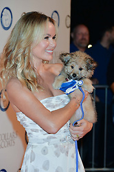 AMANDA HOLDEN and Battersea dog at Battersea Dogs & Cats Home's Collars & Coats Gala Ball held at Battersea Evolution, Battersea Park, London on30th October 2014.