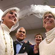 Osceola County Commisioner Cheryl Grieb, left, and Patti Daugherty, right, smile as they turn to the crowd after Osceola County Florida's first gay marriage was performed shortly after midnight on January 6, 2015 at the Osceola County courthouse in Kissimmee, Florida.  (AP Photo/Alex Menendez)