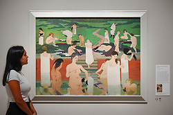 """© Licensed to London News Pictures. 27/06/2019. LONDON, UK.  A staff member views """"Bathing on a Summer Evening (Le Bain au soir d'été)"""", 1892-93, by Félix Vallotton. Preview of """"Félix Vallotton:  Painter of Disquiet"""", an exhibition of paintings and prints Swiss artist Félix Vallotton at the Royal Academy of Arts.  Around 100 works are on show 30 June to 29 September 2019.  Photo credit: Stephen Chung/LNP"""