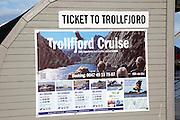 Ticket office for Trollfjord cruise, Svolvaer, Lofoten Islands, Nordland, Norway Thon hotel in background