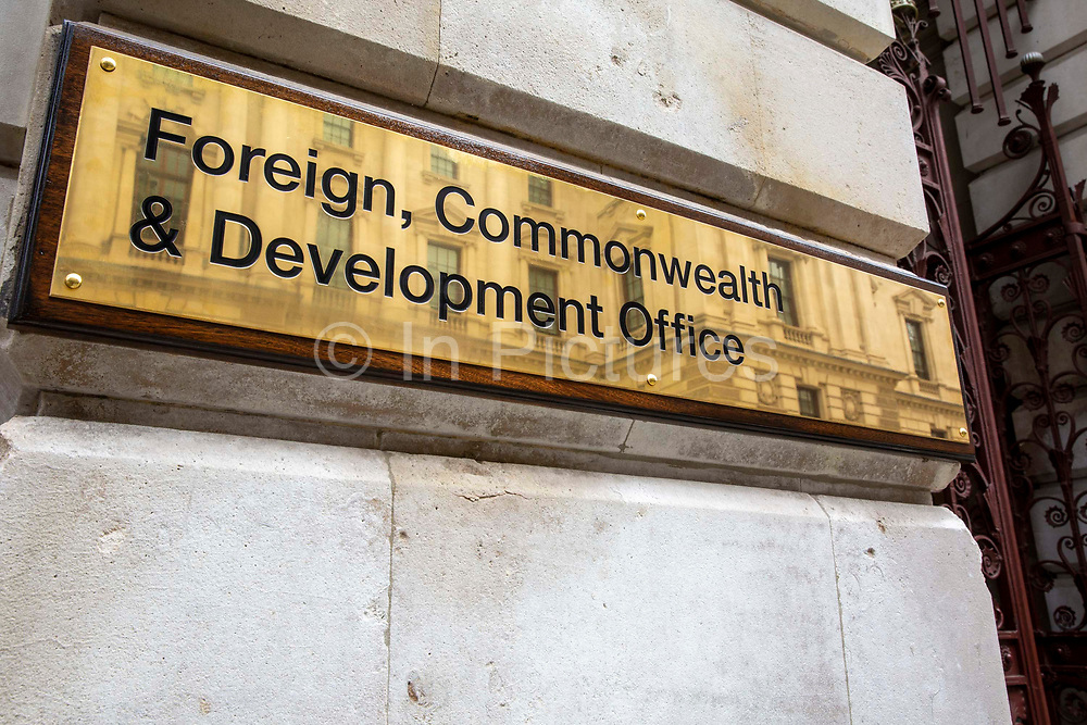 The Foreign and Commonwealth Office brass plaque sign outside the office building on King Charles Street on the 8th of September 2020 in Westminster, London, United Kingdom. The Foreign Office launched a rebrand and merger as the Foreign, Commonwealth and Development Office on the 1st of September 2020, the current secretary of state is Dominic Raab MP.