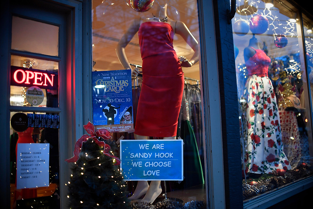A sign in a window of a dress shot in the Sandy Hook section of Newtown, Conn, Saturday, Dec. 2, 2017.  Makeshift memorials are long gone with only subtle touches in town of 12/14. (Jessica Hill for the New York Times)