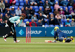 Surrey's Ben Foakes attempts to run out Glamorgan's Kieran Carlson<br /> <br /> Photographer Simon King/Replay Images<br /> <br /> Vitality Blast T20 - Round 14 - Glamorgan v Surrey - Friday 17th August 2018 - Sophia Gardens - Cardiff<br /> <br /> World Copyright © Replay Images . All rights reserved. info@replayimages.co.uk - http://replayimages.co.uk