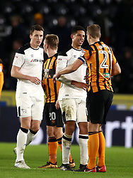 Derby County's Curtis Davies shakes hands with Hull City's Michael Dawson (right)