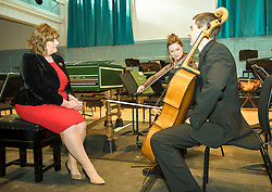 Pictured: Fiona Hyslop, Culture Secretary chats with musicians Marciana Buta (violin) and Donald Gillan (cello)<br /> Culture Secretary Fiona Hyslop announced a £650,000 grant for building improvements at the Queen's Hall, Edinburgh.<br /> © Jon Davey/ EEm