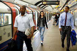 © Licensed to London News Pictures. 23/05/2016. London, UK. Commuters wait for a Victoria line train at King's Cross Underground station in London on 23 May 2016. The long-awaited 24-hour weekend service is officially announced to begin on 19 August 2016 on the Central and Victoria lines, with the Piccadilly, Jubilee and Northern to follow in the autumn. Photo credit: Tolga Akmen/LNP