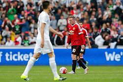 Wayne Rooney of Manchester United looks dejected after Bafetibis Gomis of Swansea City scores a goal to make it 2-1 - Mandatory byline: Rogan Thomson/JMP - 07966 386802 - 30/08/2015 - FOOTBALL - Liberty Stadium - Swansea, Wales - Swansea City v Manchester United - Barclays Premier League.