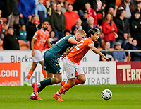 Football - 2021 / 2022 EFL Carabao Cup - Round One: Blackpool vs. Middlesbrough<br /> <br /> Kenny Dougall of Blackpool goes past Josh Coburn of Middlesbrough, at Bloomfield Road.<br /> <br /> COLORSPORT/ALAN MARTIN