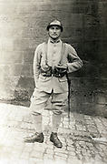 vintage portrait of French soldier posing against wall with shooting practice target marking