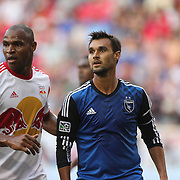 Chris Wondolowski, (right), San Jose Earthquakes, is defended by Jamison Olave, New York Red Bulls, during the New York Red Bulls Vs San Jose Earthquakes, Major League Soccer regular season match at Red Bull Arena, Harrison, New Jersey. USA. 19th July 2014. Photo Tim Clayton