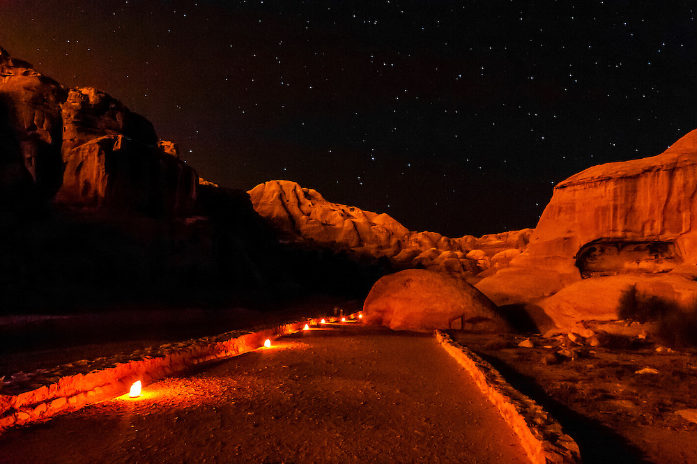 Candles illuminate the path at night leading to The Siq, the 1200 meter long gorge that leads into the Petra Archaeological Park, Jordan.