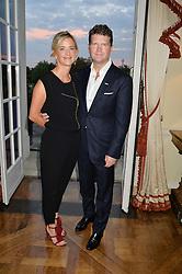 US Ambasador MATTHEW BARZUN and MRS BROOKE BARZUN at a party to kick off London Fashion Week hosted by US Ambassador Matthew Barzun and Mrs Brooke Brown Barzun with Alexandra Shulman in association with J.Crew hrld at Winfield House, Regent's Park, London on 18th September 2015.