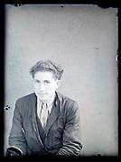 vintage formal studio portrait of adult man, circa 1930s