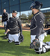 GLENDALE, ARIZONA - FEBRUARY 20:  Catchers James McCann #33 (L), Wellington Castillo #21 and Alfredo Gonzalez #89 (R) of the Chicago White Sox look on during spring training workouts on February 20, 2019 at Camelback Ranch in Glendale Arizona.  (Photo by Ron Vesely). Subject:   James McCann; Wellington Castillo; Alfredo Gonzalez