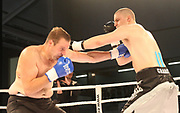Boxing: Cruiserweight, Heavyweight, Adrian Granat (SWE) - Andreas Kapp (AUT), Hamburg, 16.05.2014<br /> Andras Kapp (AUT, l.) - Andrian Granat (SWE)<br /> ©Torsten Helmke