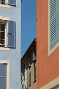 Narrow street with old tenement houses with shuttered windows, Cannes, France.