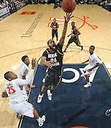 CHARLOTTESVILLE, VA- DECEMBER 6: Ryan Pearson #24 of the George Mason Patriots shoots between Virginia Cavalier defenders during the game on December 6, 2011 at the John Paul Jones Arena in Charlottesville, Virginia. Virginia defeated George Mason 68-48. (Photo by Andrew Shurtleff/Getty Images) *** Local Caption *** Ryan Pearson