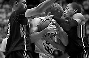 BYU guard Tyler Haws (3), center, is swarmed by Cal State defenders during the second half of the NCAA basketball game between BYU and Cal State Northridge, Saturday, Nov. 24, 2012.