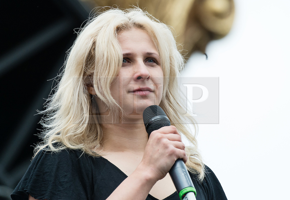 © Licensed to London News Pictures. 26/06/2015. Pilton, UK.  Members of Pussy Riot at Glastonbury Festival 2015 on Friday Day 3 of the festival on the Park Stage.  The members stage a struggle with a man in a balaclava symbolising oppression on top of an army truck, before being having a talk with Charlotte Church.  In this picture - Maria Alyokhina.  This years headline acts include Kanye West, The Who and Florence and the Machine, the latter being upgraded in the bill to replace original headline act Foo Fighters.   Photo credit: Richard Isaac/LNP