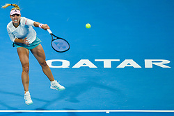 DOHA, Feb. 14, 2019  Angelique Kerber hits a return during the singles second round match between Anett Kontaveit of Estonia and Angelique Kerber of Germany at the 2019 WTA Qatar Open in Doha, Qatar, on Feb. 13, 2019. Angelique Kerber won 2-0. (Credit Image: © Xinhua via ZUMA Wire)