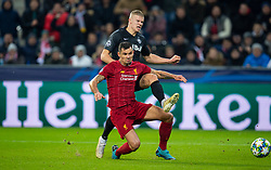 SALZBURG, AUSTRIA - Tuesday, December 10, 2019: Liverpool's Dejan Lovren (L) challenges FC Salzburg's Erling Braut Håland during the final UEFA Champions League Group E match between FC Salzburg and Liverpool FC at the Red Bull Arena. (Pic by David Rawcliffe/Propaganda)