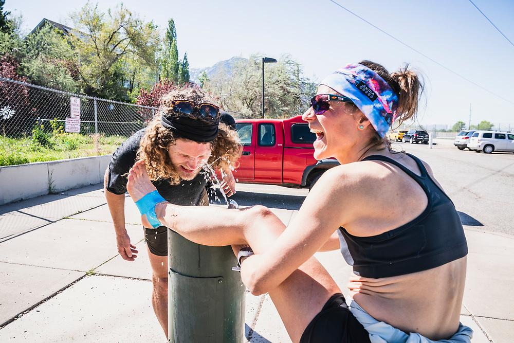 """""""Got water?"""" As Hillary Gerardi cools her sprained ankle Joe Grant get rehydrated, Grandeur Peak trailhead, Salt Lake City."""