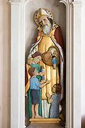Sculpture statue of Saint Nicholas with children inside village parish church of Saint Nicholas, Hintlesham, Suffolk, England, UK