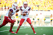 WACO, TX - SEPTEMBER 2:  Stephen Calvert #12 of the Liberty Flames hands the ball off to Carrington Mosley #34 against the Baylor Bears during a football game at McLane Stadium on September 2, 2017 in Waco, Texas.  (Photo by Cooper Neill/Getty Images) *** Local Caption *** Stephen Calvert; Carrington Mosley