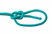 Bowline Knot on white background one of the most used loop knots. As it does not slip it is used for rescue