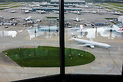 Aerial view (from control tower) showing expanse of airport land with airliners at London Heathrow.