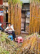 02 FEBRUARY 2013 - PHNOM PENH, CAMBODIA:  Sugar cane for sale in a market in Phnom Penh, Cambodia.      PHOTO BY JACK KURTZ