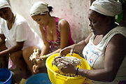 Women have different roles in the ceremonies such as plucking the chickens before they are eaten. Santeria is a syncretic religion practiced in Cuba, it is a mixture of Yoruba tribal practices brought from Nigeria during Colonial times, and traditional Catholic beliefs. During this time, the slaves used the images of saints to cover up their worship of the Orishas (spirits)
