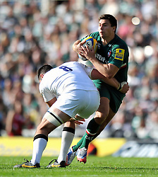 Leicester Tigers scrum half Ben Youngs looks to offload the ball after being tackled - Photo mandatory by-line: Patrick Khachfe/JMP - Tel: Mobile: 07966 386802 - 21/09/2013 - SPORT - RUGBY UNION - Welford Road Stadium - Leicester Tigers v Newcastle Falcons - Aviva Premiership.